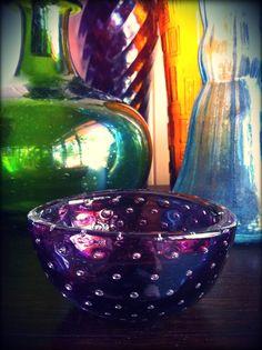 Purple glass spotty dish.