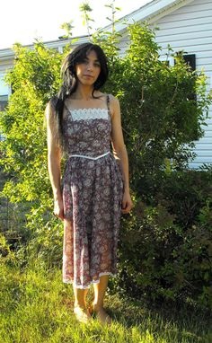 http://www.etsy.com/listing/52156893/vintage-70s-floral-gunne-sax-dress-xs
