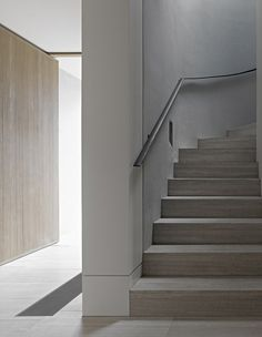 pale minimal staircase in soft pale wood and white Cassell Street House by b.e. Architecture