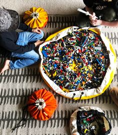 Is the LEGO mess driving you crazy? Swoop Bags to the rescue. Durable, modern toy bags that make cleanup time simple. Toy Storage Solutions, Toy Storage Bags, Toy Bins, Lego Storage, Storage Ideas, Playroom Storage, Playroom Decor, Lego Bag, Modern Toys