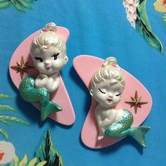 Beach House •~• Mid-Century Modern aqua/turquoise mermaids on pink boomerangs
