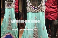 Mint dress with heavy embellished front dull silver dabka work.Chiffon outfit with embroidered front and zardozi touching everything is stunning...Sleeveless shirt with kora , pearls , diamantes hand work ..Shimmery sequins dull silver it is a long stylish chiffon tail frock with blue pipping ...