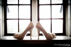 White wedding shoes in window
