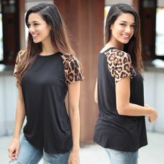 Wild and Fierce! We love this super cool light weight Black Top With Leopard Sleeves. Featuring short sleeves and super soft fabric! Check out other awesome tops at our online boutique!
