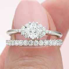 This dainty engagement ring features a princess cut diamond and accent diamonds cluster set on each side to create a tapering look. It was created. Dainty Engagement Rings, Diamond Cluster Engagement Ring, Princess Cut Rings, Princess Cut Engagement Rings, Princess Cut Diamonds, Peach Sapphire, Quality Diamonds, Unique Rings, White Gold Rings