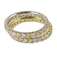 alternating fancy yellow and white shared prong stackable bands   From a unique collection of vintage band rings at http://www.1stdibs.com/jewelry/rings/band-rings/