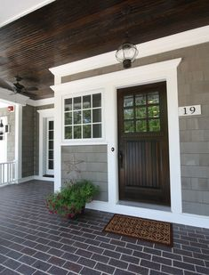 Country front doors entry beach style with gray shingles dentil molding