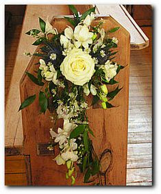 Google Image Result for http://www.flowersfromfiona.com/images/weddings_pew_swags_02.jpg