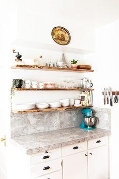 Live-edge wood floating kitchen shelves