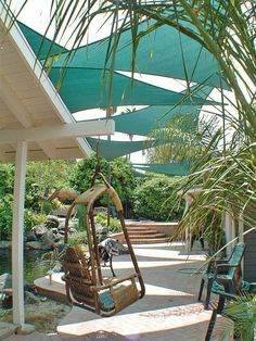 <<GREAT IDEAS in many of the pictures (for ex. the bamboo swing, rocks in fence used for table legs) & more                         9 Clever DIY Ways for a Shady Backyard Oasis