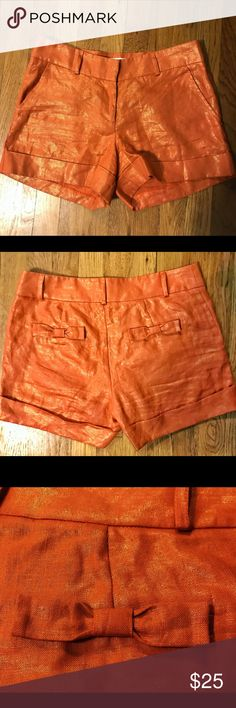 Britt Ryan Orange & Gold Shimmer Linen Shorts sz 6 Genuine Britt Ryan brand 100% linen shorts! The color is a dark burnt orange with an all over gold shimmer. The back pockets have a cute bow detail. Perfect for warmer weather in the fall! These shorts got very minimal use, I wore them no more than 2 or 3 times. Like new condition! Size 6 britt ryan Shorts