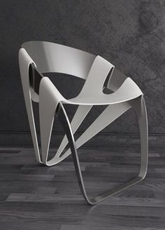 Dry Leaf Chair by Wilmer Chaca Material : 2 pieces of metal Production : cutting metal plate and blend to shape, and coloring with powder coating. User:everyone Location:dinning room ,kitchen,office and living room Experimental chair