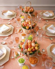 Cheerful pastel orange themed tablescape for #Easter! Easy to pull off, it would look as charming in any other color. Simple tablecloth and fresh baskets of spring tulips, wine/wine glass in the same shade to tie it all neatly!