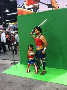 Father and daughter in matching Wonder Woman outfits make the perfect cosplay pair