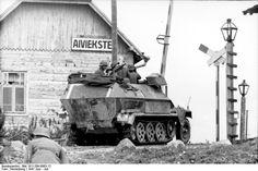 German SdKfz. 251/1 halftrack vehicle at a rail crossing, Aiviekstes, Latvia, Jun 1941.