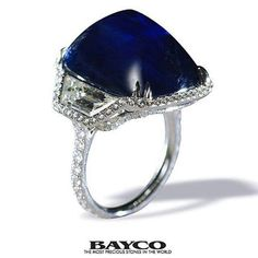 repost from @baycojewels From The Mogul Collection - A platinum ring centered upon a beautiful 30 carat sugarloaf Ceylon sapphire flanked by trapezoid diamonds all set within a diamond micropavé surround. #bayco
