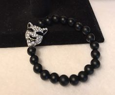 A personal favorite from my Etsy shop https://www.etsy.com/listing/503315880/tiger-charm-bracelet-black-tiger-charm