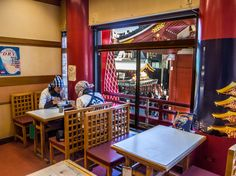"""We've said it before: the shafu (jinrikisha/rickshaw drivers) are the hardest working men and women in Asakusa so they deserve a rest! Here, two of them taking a lunch break at """"Kaminari Shokudo"""" above the """"Tokiwado"""" confectionery (https://www.pinterest.com/pin/196047390004505306/) right next to the Kaminarimon Gate and the entrance of Nakamise Dori. #Asakusa, #shafu, #jinrikisha, #rickshaw, #Shokudo, #Kaminarimon, #Tokiwado January 31, 2015 © Grigoris A. Miliaresis"""