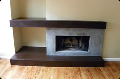 Asymmetrical, two-color, concrete fireplace surround…