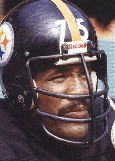 """Mean Joe (Charles Edward) Greene - b 09/24/1946 in Elgin, Texas - A former all-pro American football defensive tackle who played for the Pittsburgh Steelers of the NFL. Throughout the early 1970s he was one of the most dominant defensive players in the National Football League. He is considered by many to be one of the greatest defensive linemen ever and was the cornerstone of the legendary """"Steel Curtain"""" defense."""