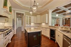 Traditional Kitchen with Aspen White Shaker, Petrous Gold Granite Countertop, Glass and Calacatta Stone Mosaic Tile