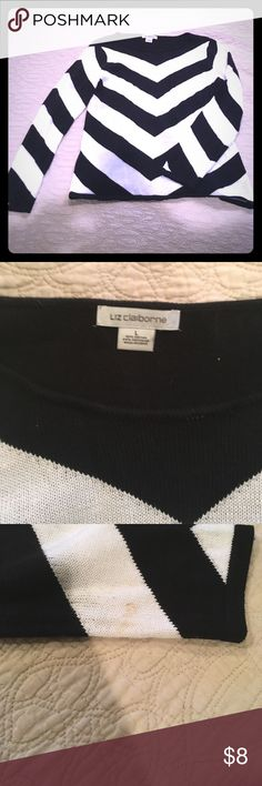 Black and white striped sweater A beautiful black and white striped Liz Claiborne sweater. Back of it is solid black. It was a hand me down, but I've never worn it. Tiny stain on the left arm, but I can see about getting it out. Super comfy! Liz Claiborne Sweaters Crew & Scoop Necks