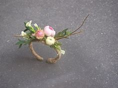 Ranunculus and sweet william on a hand-woven twine corsage