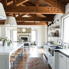 We're loving the warmth and grand scale of this kitchen/great room by our friends Shea and Syd over at Studio McGee. Plus that marble island the size of Connecticut isn't too shabby, either. They always get it right (and keep their #brownbottle #sinksidestyle game on point, too)  found via @betterhomesandgardens