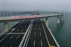 The world's longest cross-sea bridge has been opened in China.   The Jiaozhou Bay bridge is 26.4 miles (42 km) long and links China's eastern port city of Qingdao to the offshore island Huangdao.