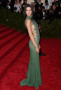 Kendall Jenner went the sexy route in a green skin-tight Calvin Klein dress with side cut-outs at the 2015 Met Gala.