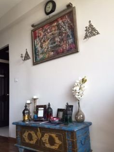 Avilasha has incorporated the brassware and other antiques and heirlooms that she has inherited, into the decor of every room! Home Tour: Avilasha's Bengaluru Home with Global Decor Accents Zebra Print Rug, Black Couches, Global Decor, Asian Paints, Ethnic Decor, Red Mirror, Brick Wallpaper, Grey Cushions, Sofa Upholstery