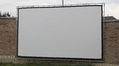 """""""Thanks Carl for making this awesome product. I had no idea that backyard movies were so popular until I stumbled onto your website. I used your kit and made a few modifications so that I could mount the screen to our wall (All removable with no drilling into the wall). It worked better than I imagined. Can't wait for movie nights!!!"""" —Greg B. 