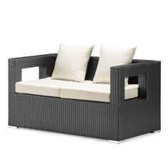 Algarve Outdoor Sofa - Grandin Road by Grandin Road. $999.00. Tough, UV-protected synthetic weave has a sleek, modern finish that resembles wicker but resists fading and cracking. Tables include tempered safety glass tops. Each piece is slightly raised on decorative square feet. Weather-resistant fabric cushions. Non-rusting aluminum frame provides long-lasting stability. Tough, UV-protected synthetic weave has a sleek, modern finish that resembles wicker but resis...