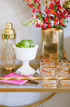 budget redo: gorgeous gold accents. Bar Cart Beauty- The sophistication of gold plays nicely with playful pink cocktail napkins. VIA @POPSUGARhome