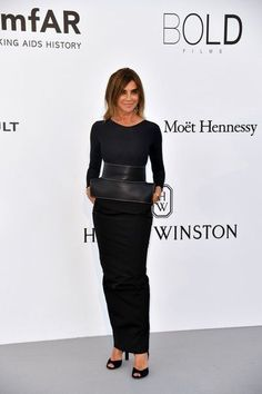 French designer and fashion editor Carine Roitfeld poses as she arrives for the amfAR's 24th Cinema Against AIDS Gala on May 25, 2017 at the Hotel du Cap-Eden-Roc in Cap d'Antibes, France. / AFP PHOTO / ALBERTO PIZZOLI