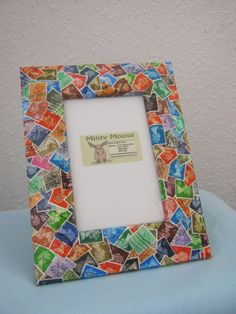 Upcycled postage stamp decorated photo frame by MooseintheMint, £18.00