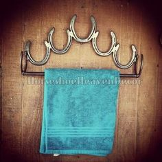 Rustic Bathroom Towel Holder, Made from Horseshoes This Unique Handcrafted Towel Holder will add that country Charm to your Bathroom . This piece comes natural with a heavy clear coat unless otherwise specified. It measures approximately 18 inches long 10 inches tall and 4 inches deep