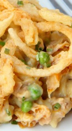 Tuna Noodle Casserole ~ Pasta and tuna in a creamy sauce topped with cheese and french fried onions... The perfect casserole for busy weeknights!