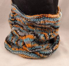 Hand knitted cowl, with lace knit detailing and scalloped edge.  Size is adult - one size fits all - snug enough to keep you warm, but not so tight as to be uncomfortable.  The hat is knitted with soft 1-ply wool, hand dyed by me - the colour-way is one of a kind featuring orange, Knit Cowl, Scalloped Edge, Lace Knitting, One Size Fits All, Snug, Knitted Hats, Colour, Warm, Orange