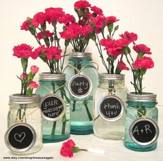 Mason Jar centerpieces.  Use chalkboard paint on lids for table numbers or short messages!