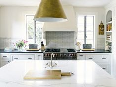 white kitchens with windows photo gallery | white marble counters, kitchen island, white kitchen cabinetry, white ...