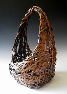 Rustic Japanese woven bamboo ikebana basket from Kyoto prefecture, Meiji period, c. 1868-1912. Gorgeous patina on golden bamboo handwoven in modified moon form.