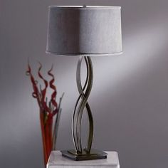 "Hubbardton Forge Almost Infinity 21.4"" Table Lamp Finish: Black, Shade Color: Natural Anna, Shade Type: Empire"