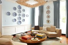 In the sitting room, a large modern chandelier dangles over an inexpensive table from Crate & Barrel.