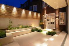 Charlotte Rowe used LED lighting and Swarovski crystals in the courtyard of a Chelsea house Garden Design Glow in the dark: night garden illumination Fence Lighting, Backyard Lighting, Landscape Lighting, Outdoor Lighting, Lighting Design, House Lighting, Modern Lighting, Wall Lighting, Outdoor Sconces