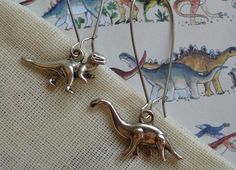 Dinosaur Earrings - Dino Dangle Earrings in Silver - Brontosaurus and Tyrannosaurus Rex / T Rex on Etsy, $6.00