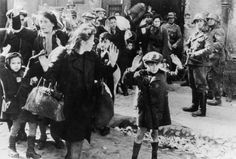 Jews from the Warsaw ghetto uprising surrender in April 1943
