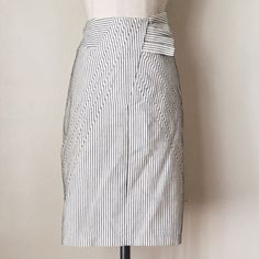 Eva Franco striped pencil skirt Gorgeous cream and black striped pencil skirt with bow waist and pleated back! Love this so much!! I recently just purchased this on posh, but unfortunately it is too tight on me :( in great condition no flaws! Just want to make back what I bought it for. Comment if you have any questions! Anthropologie Skirts Pencil
