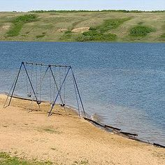 Canada's Top 10 Beaches | Manitou Beach, Saskatchewan  100 km southeast of Saskatoon is curious Little Manitou Lake, which a century ago rivaled Jasper and Banff for tourists. The salty water is so buoyant you can lie back in it and read a book. There are three beaches with showers and washrooms, and a children's playground. The Manitou Beach Village has a mineral spa and resort, and there's camping and golf in the area.