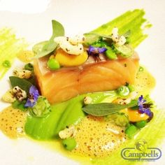 Loch Duart salmon confit in lemon verbena, peas and mussels with a velvet crab sauce.